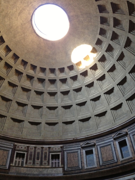The dome of the Pantheon, with round window at the top letting in sunlight, and original rectangular windows at lower left of photo.