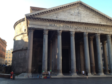 Side view of the Pantheon exterior. You can see the round shape behind the columns.