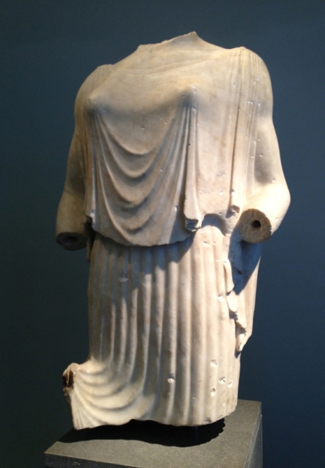 Peplophoros (a sculpture). She is wearing a peplos of thin, clinging fabric carved in the manner of Ionic garments. In the Museo Nazionale Romano.