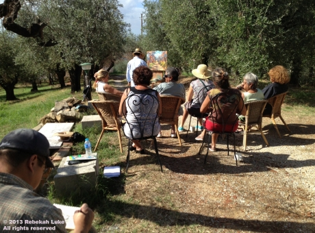 Agostino Veroni demonstrates his style of plein air oil painting to students in the olive grove. Please see the finished painting below.