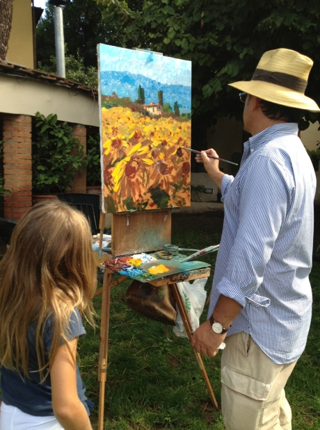 Agostino paints while daughter Giorgia, 7, watches