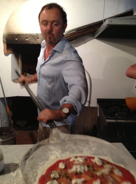 Agostino makes pizza