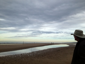 Omaha Beach at low tide, long and wide.